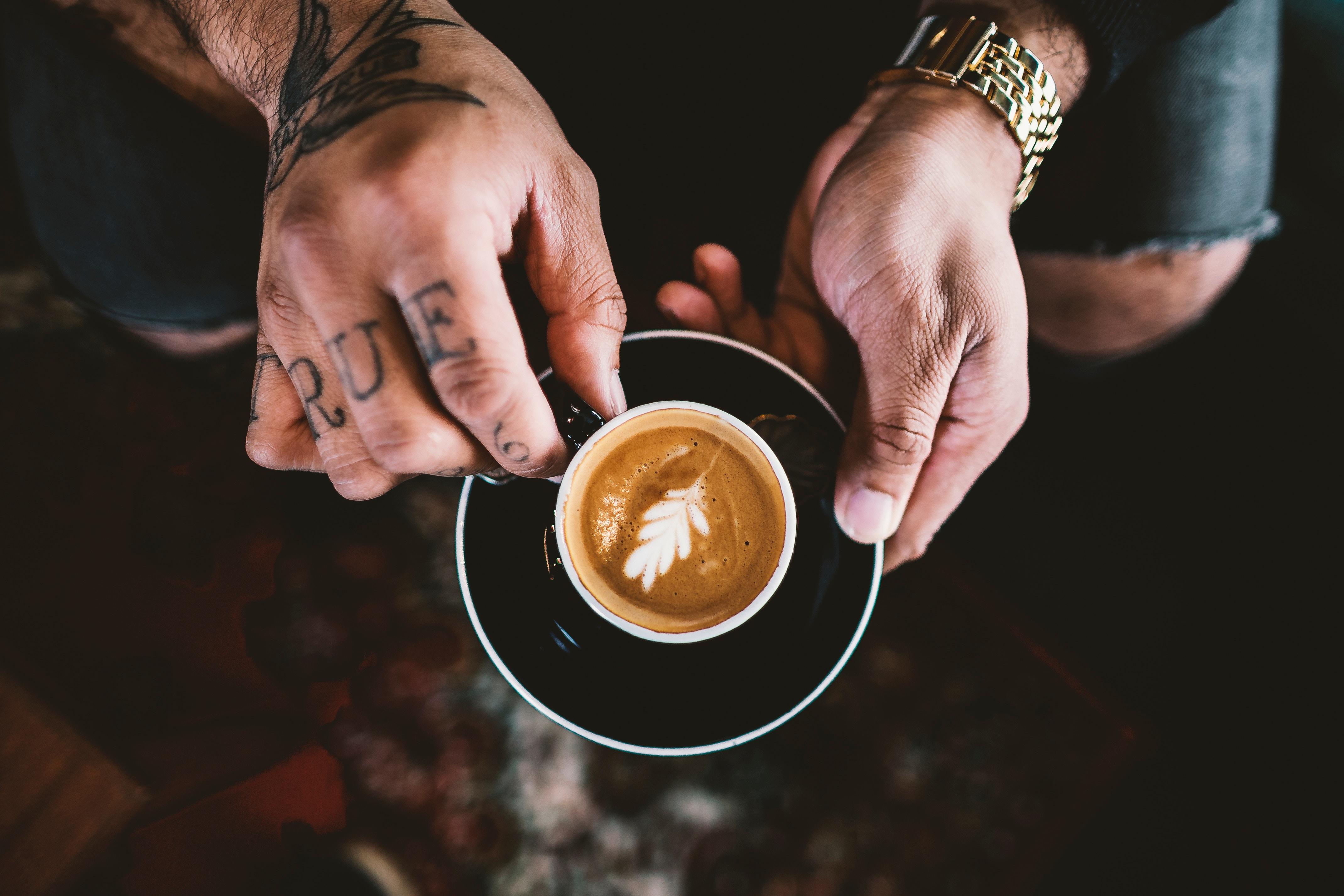 unsplash biker drinking coffee